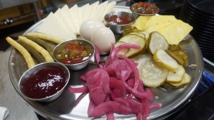 The house pub plate full of Cabot cheddar, handmade local pickled red onions, pickled eggs, pepper jelly and more